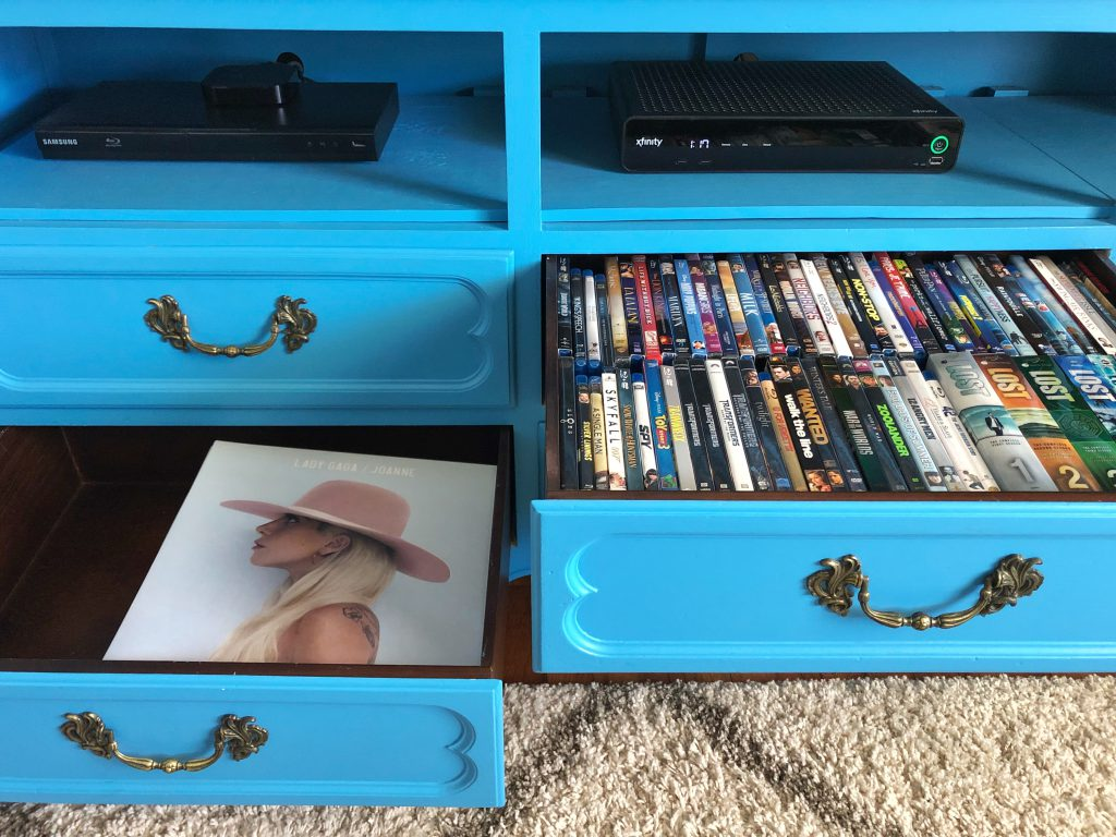 The TV Stand drawers hold DVDs, records, board games, and other thing